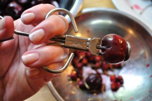 Cherry loaded into pitter - Food Gypsy
