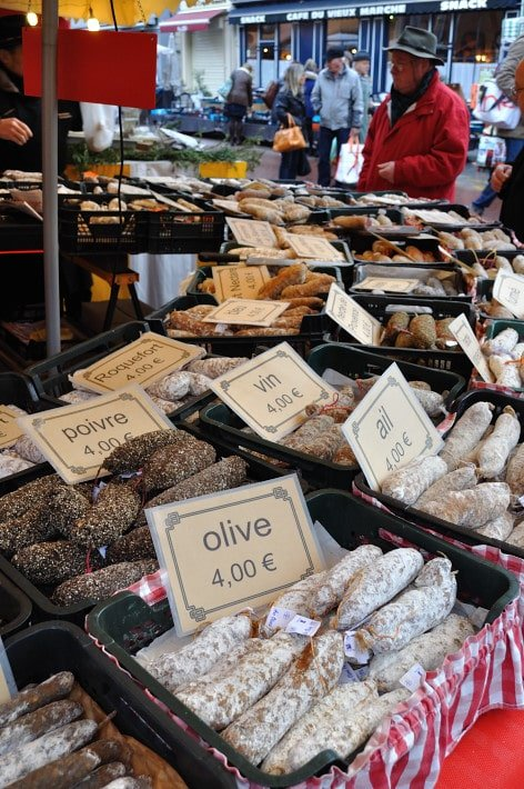 Charcuterie stall, outdoors.  Dijon Market - Food Gypsy