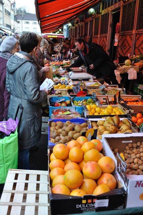 Produce stall, outdoors.  Dijon Market - Food Gypsy