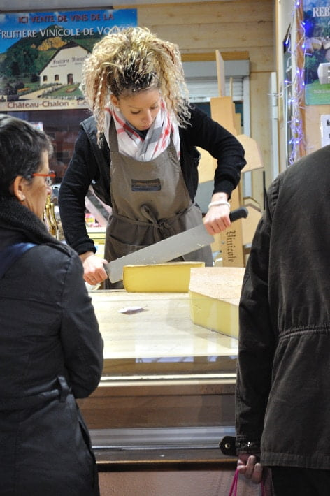 Cutting wheels of cheese, Les Halles - Food Gypsy