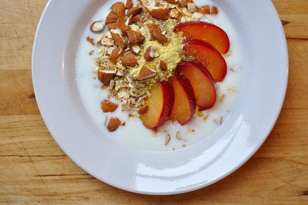 Grains, nuts, fruit, kifir, nutritional yeast, flax & agave.  Breakfast.  - Food Gypsy